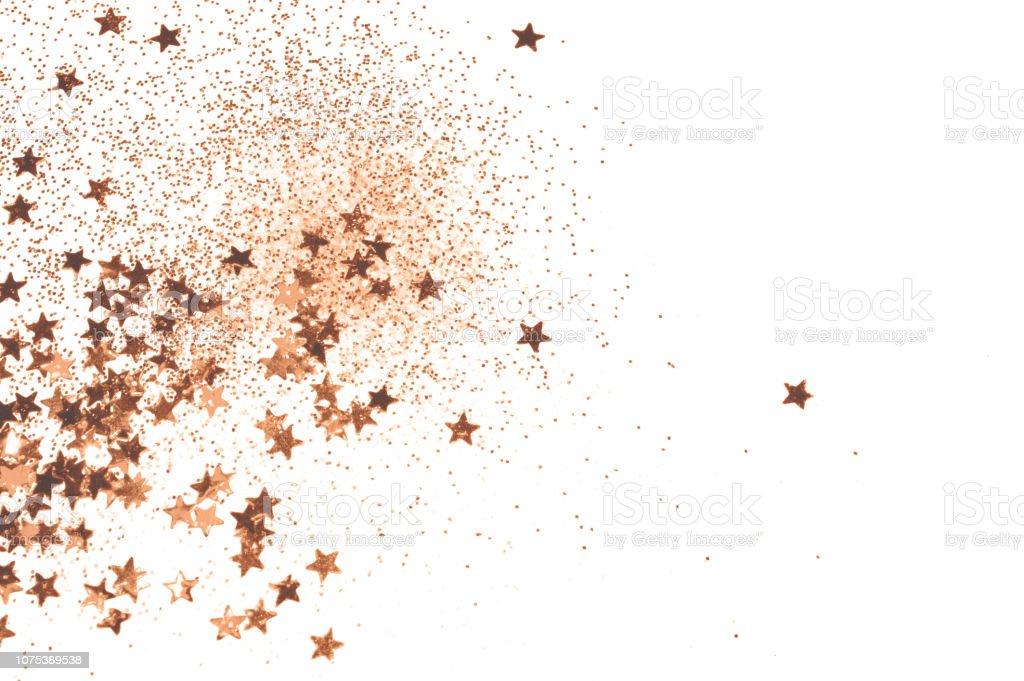 Rose gold glitter and glittering stars on light gray background for...