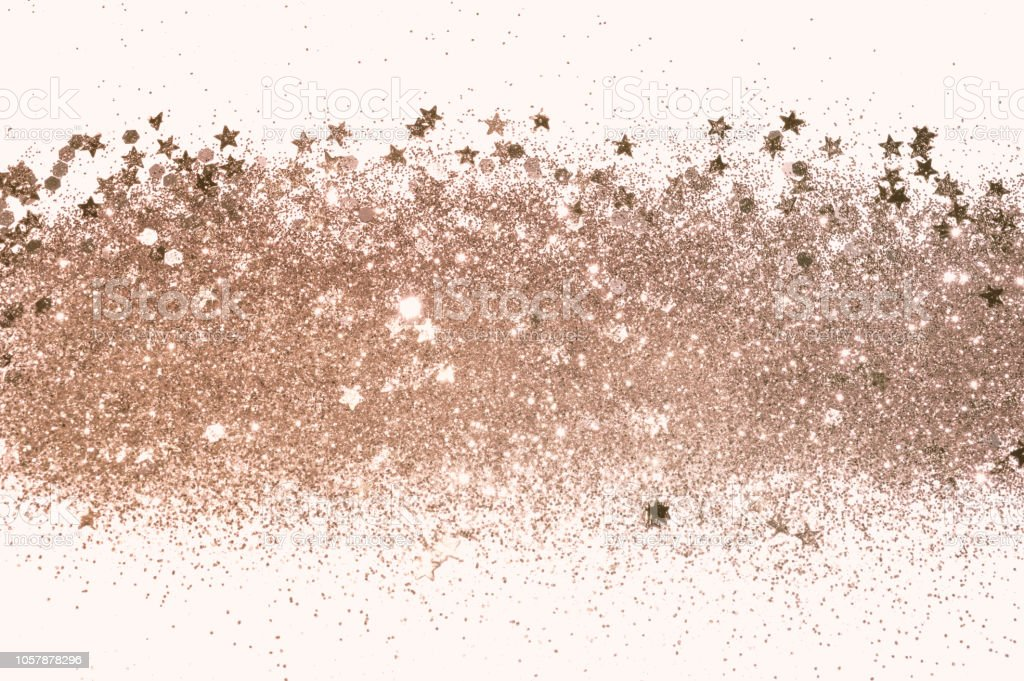 Rose gold glitter and glittering stars on white background in vintage...