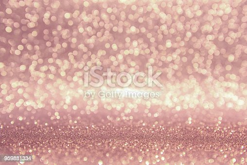 istock Rose gold glitter, Defocused abstract holidays lights on background. 959881334