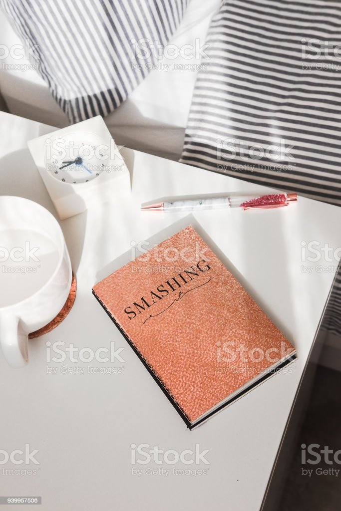 Rose gold glitter notebook and pen on white stock photo