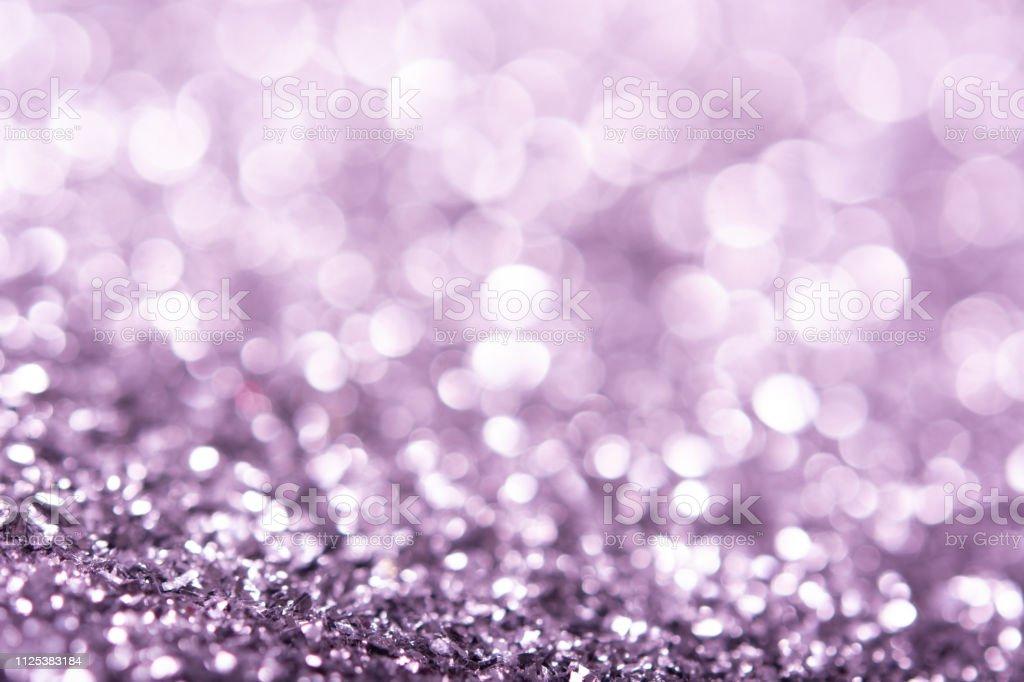 Rose gold glitter texture. Festive sparkling sequins background...