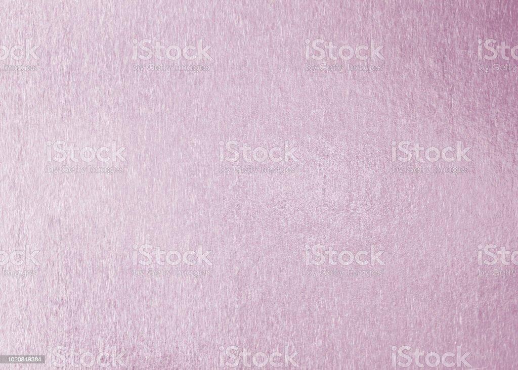 Rose gold pink purple color shiny paper foil leaf texture background...