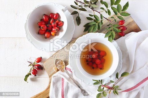 istock Rose hip tea and berries, healthy extract 826093908