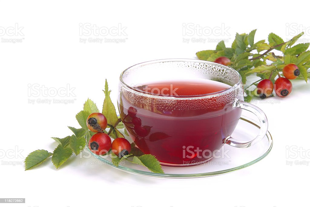 Rose hip tea on a clear cup and saucer set stock photo