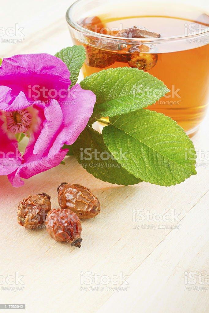 rose hips tea, sweet briar berries and flower stock photo