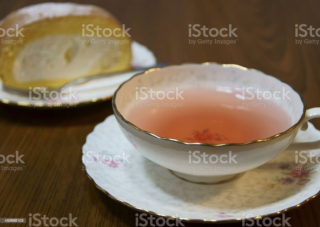 Rose hips tea and roll cake stock photo