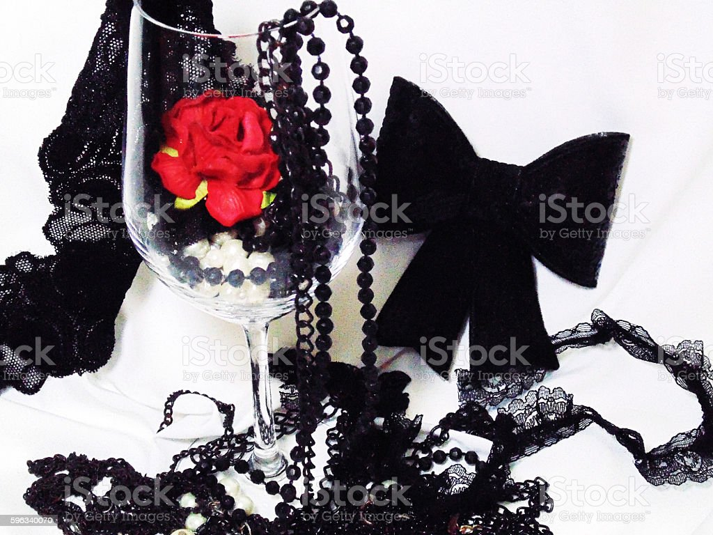 rose in the glass with black accessory Lizenzfreies stock-foto