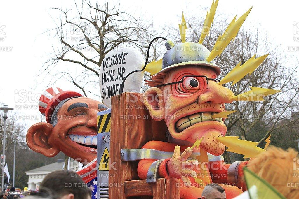 Rose Monday carnival float Obama Snowden stock photo