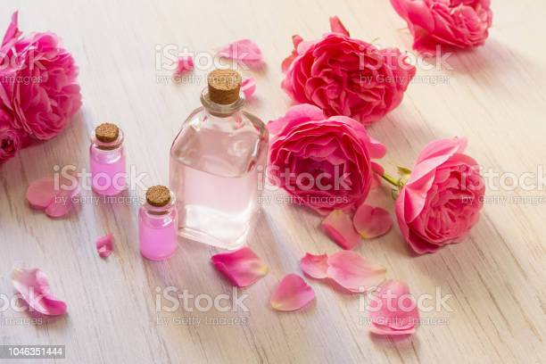 Rose oil in glass bottles and rose flower petals on white wooden picture id1046351444?b=1&k=6&m=1046351444&s=612x612&h=fc6bchblkczlhbztezw r gdf72bmwegw7h3evk0dhm=