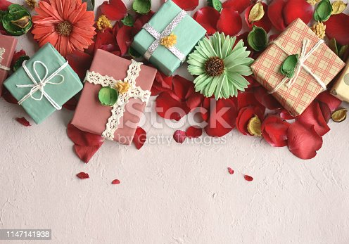 825251738istockphoto rose petals and gift box 1147141938