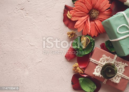 825251738istockphoto rose petals and gift box 1147150415