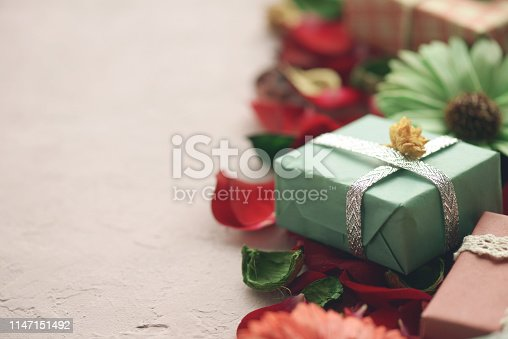 825251738istockphoto rose petals and gift box 1147151492