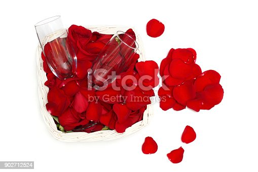 istock Rose petals, heart and two glasses of wine - love concept 902712524