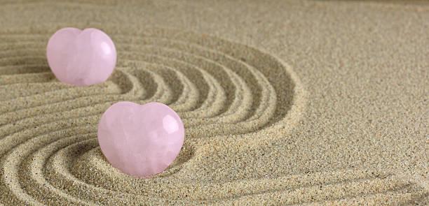Rose Quartz heart in zen garden stock photo