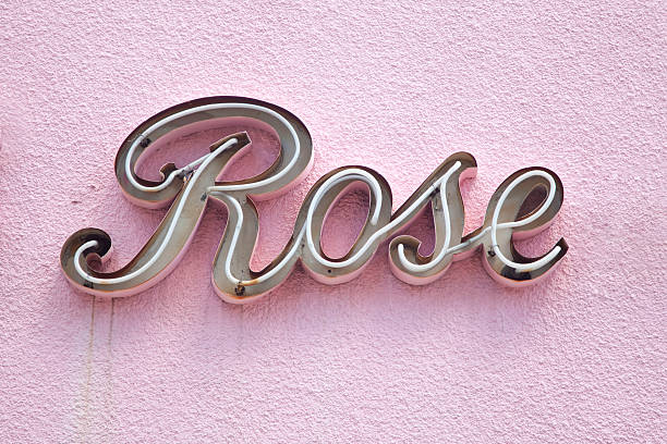 Rose Sign on Pink Stucco Wall stock photo
