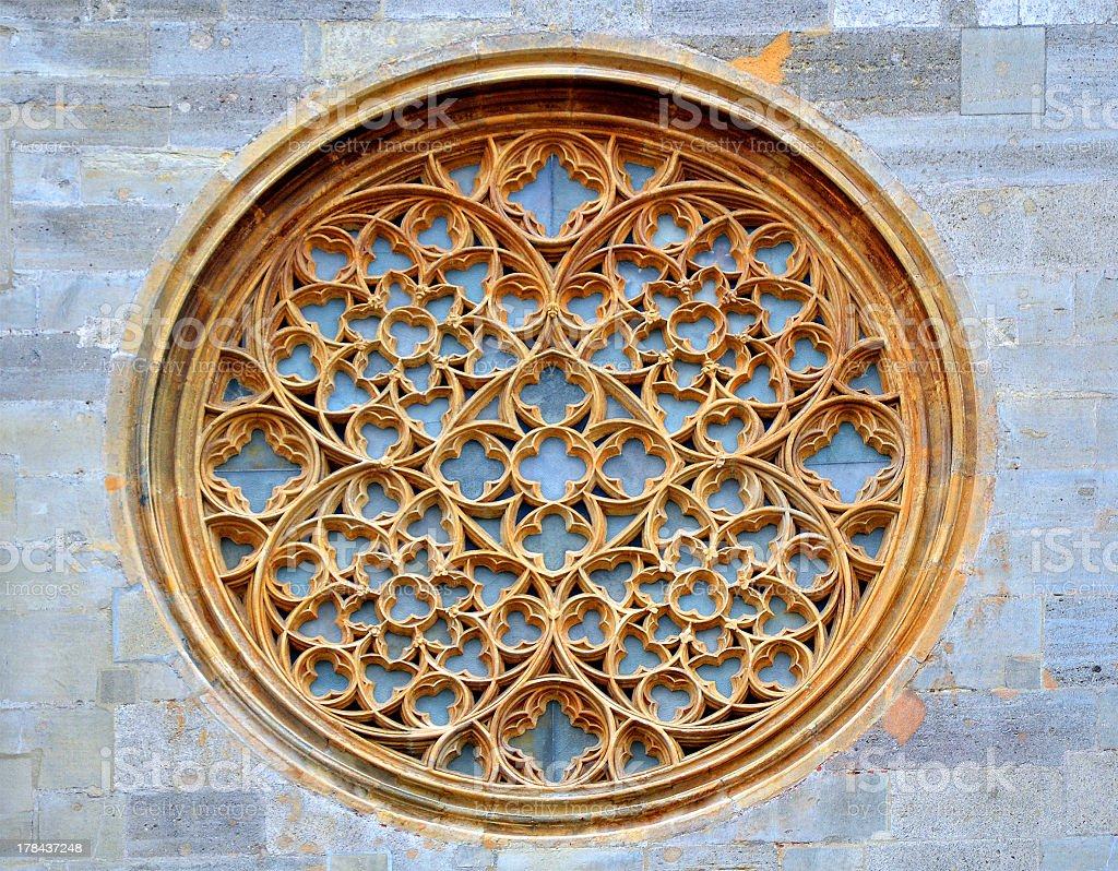 Rose stained glass window on Stephansdom facade in Vienna royalty-free stock photo