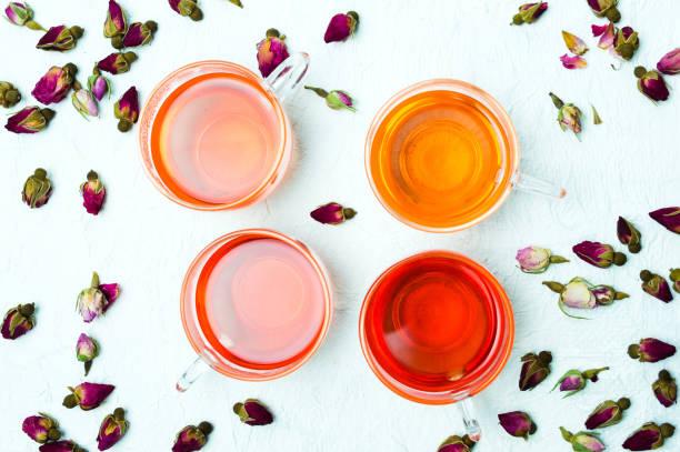 Rose tea and flower petals on white background picture id951698854?b=1&k=6&m=951698854&s=612x612&w=0&h=jqwdlcoatbq4l8vwkq9tv2f6obpwa2jqdvfqbbo1oea=