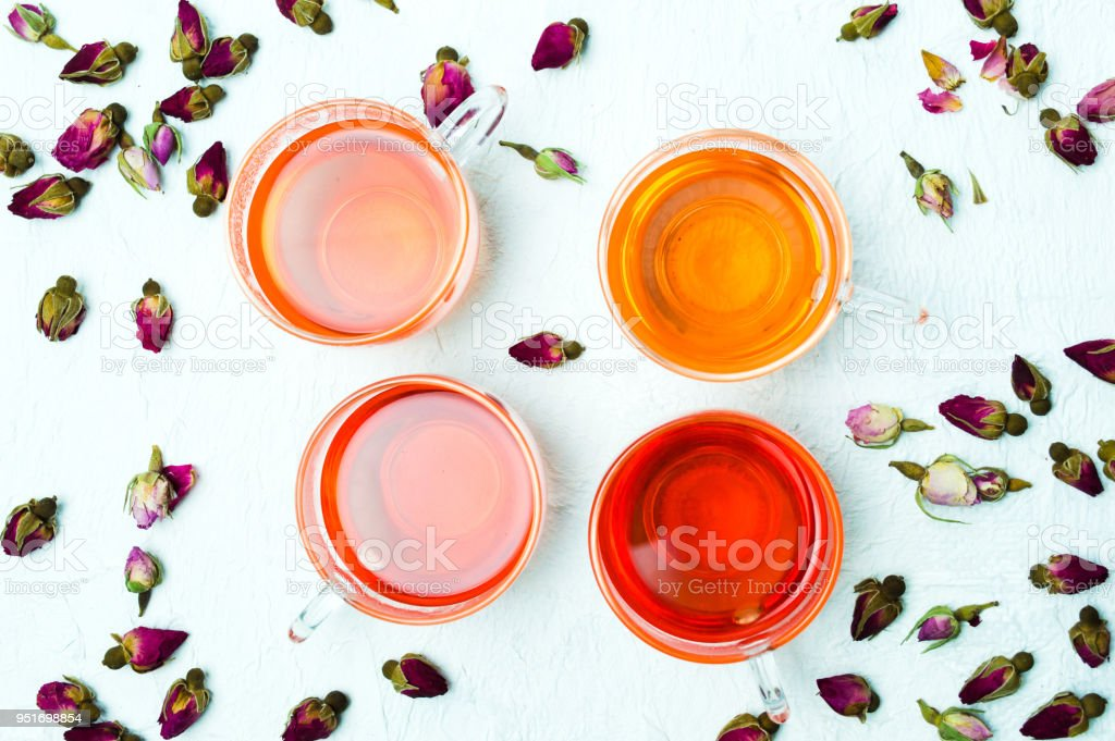 Rose tea and flower petals on white background - foto stock