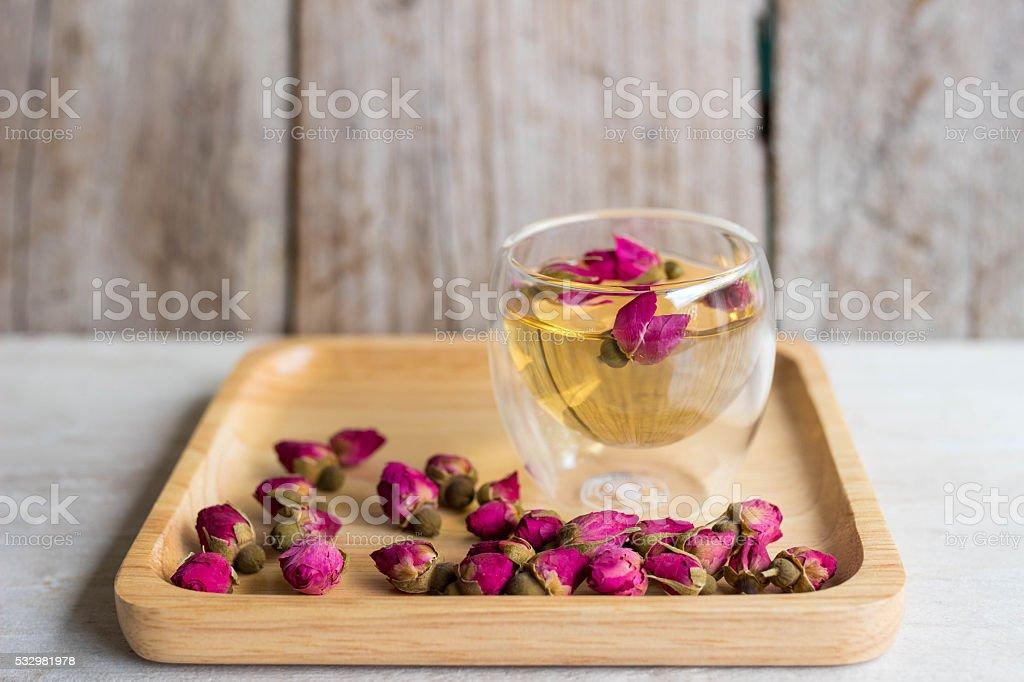 Rose tea on wooden desk , soft focus stock photo
