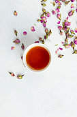 Rose tea on white background. Directly above.