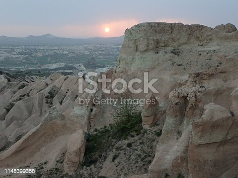 Cappadocia,Turkey - April 30 2019: Here is the Rose Valley of Cappadocia, Turkey. Located in the Cavusin district. Rose Valley is beautiful in the Sunrise ,sunset time, and many colorful balloons fly. Many travelers from around the world visit to see the beautiful scenery.