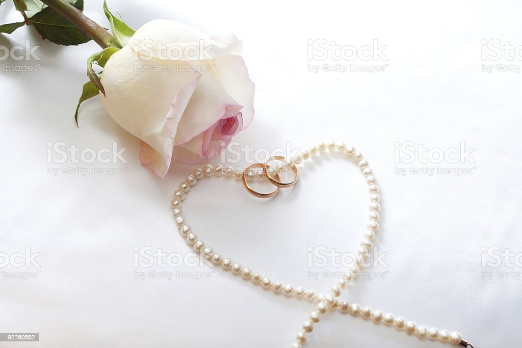 Rose, wedding rings, perl necklace royalty-free stock photo