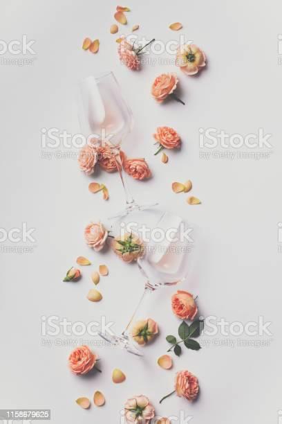 Rose wine and roses on white background picture id1158679625?b=1&k=6&m=1158679625&s=612x612&h=ir4wj1hep5 2ijwjlunpqbkrixx9nhfnmr3ubigx0 o=