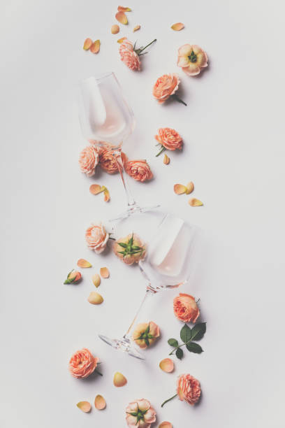 Rose wine and roses on white background stock photo