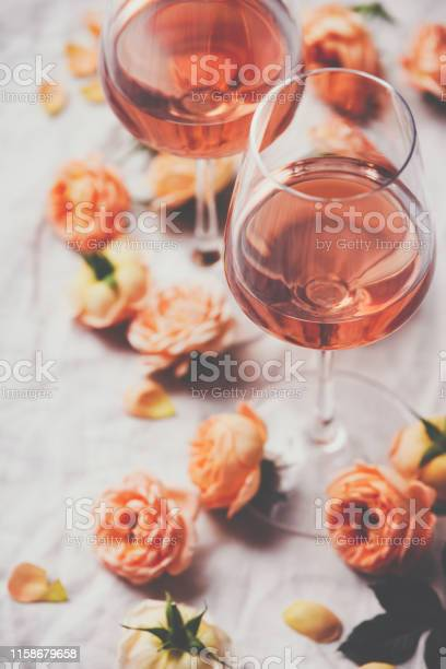 Rose wine and roses on white background picture id1158679658?b=1&k=6&m=1158679658&s=612x612&h=24cunx1ktjoe4jzvvhntgrhnogoqouayy9syxb1pfb0=