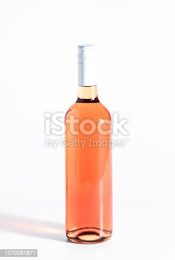 Rose wine bottle on the white table. Rosado, rosato or blush wine tasting in wineshop, bar concept. Copy Space