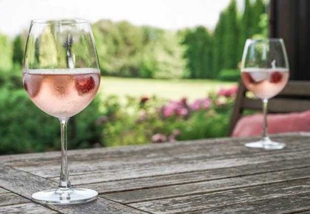 Rose wine glasses on a wooden table at garden picture id1094934074?b=1&k=6&m=1094934074&s=612x612&w=0&h= cru lnvplj9s4sqjl8vgijgjhpgnlm4hbc7rx4ltnq=