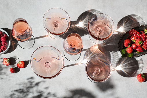 Rose Wine Glasses with Summer Berries and Shadows