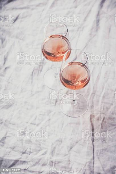 Rose wine in glasses on white linen cloth picture id1158679632?b=1&k=6&m=1158679632&s=612x612&h=nf129wj3dbvllhljabcfmf8ezy2d86rxmrmi82hbhcu=