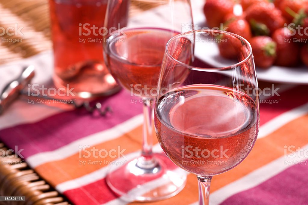 Rose wine picnic with glasses and strawberries royalty-free stock photo