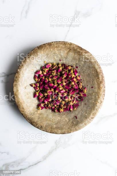 Rosebuds in a stone plate
