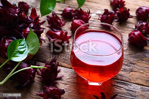Roselle juice on wooden background, herbal organic tea for good healthy and refreshment.