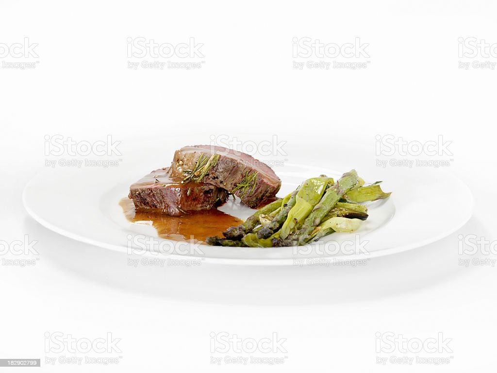 Rosemary Beef Tenderloin with Roasted Asparagus royalty-free stock photo