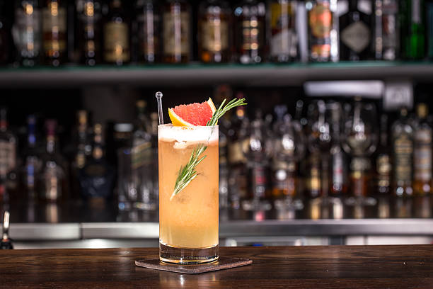 rosemary cocktail - grapefruit cocktail stock photos and pictures