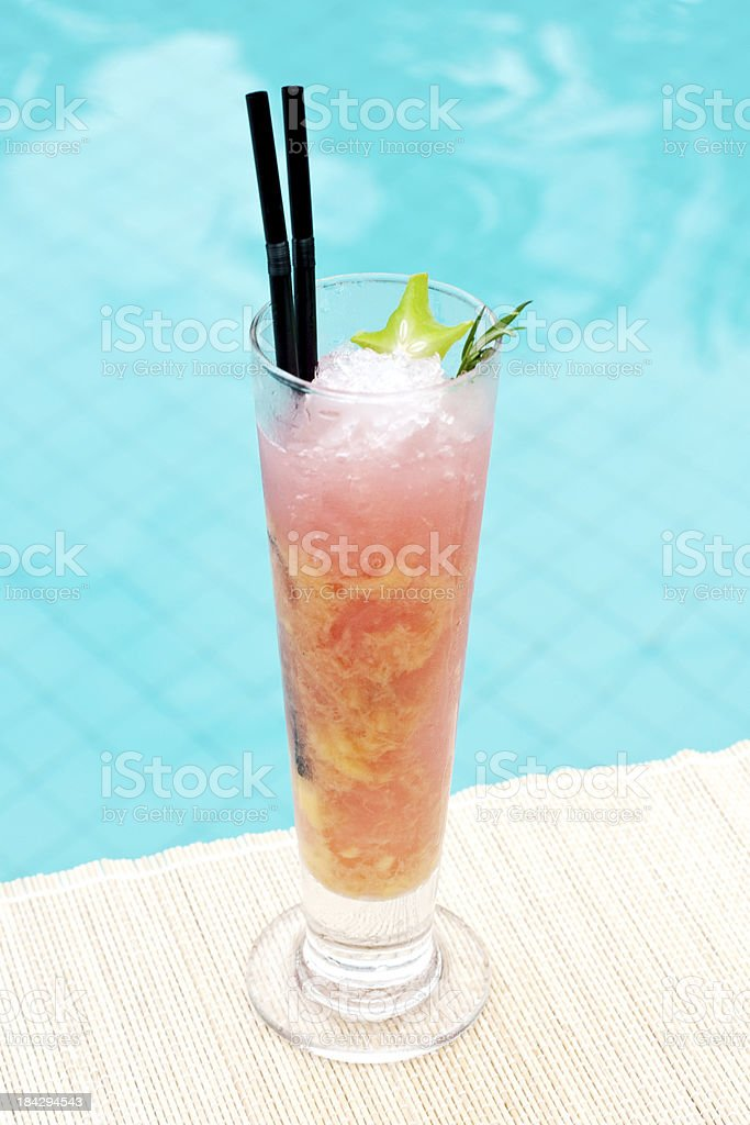 Rosemary Cooler cocktail near waterpool on the mat stock photo
