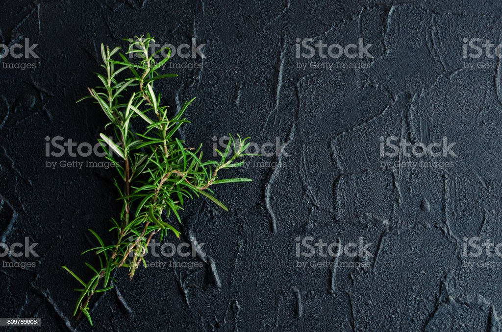 Rosemary herb on stone table stock photo