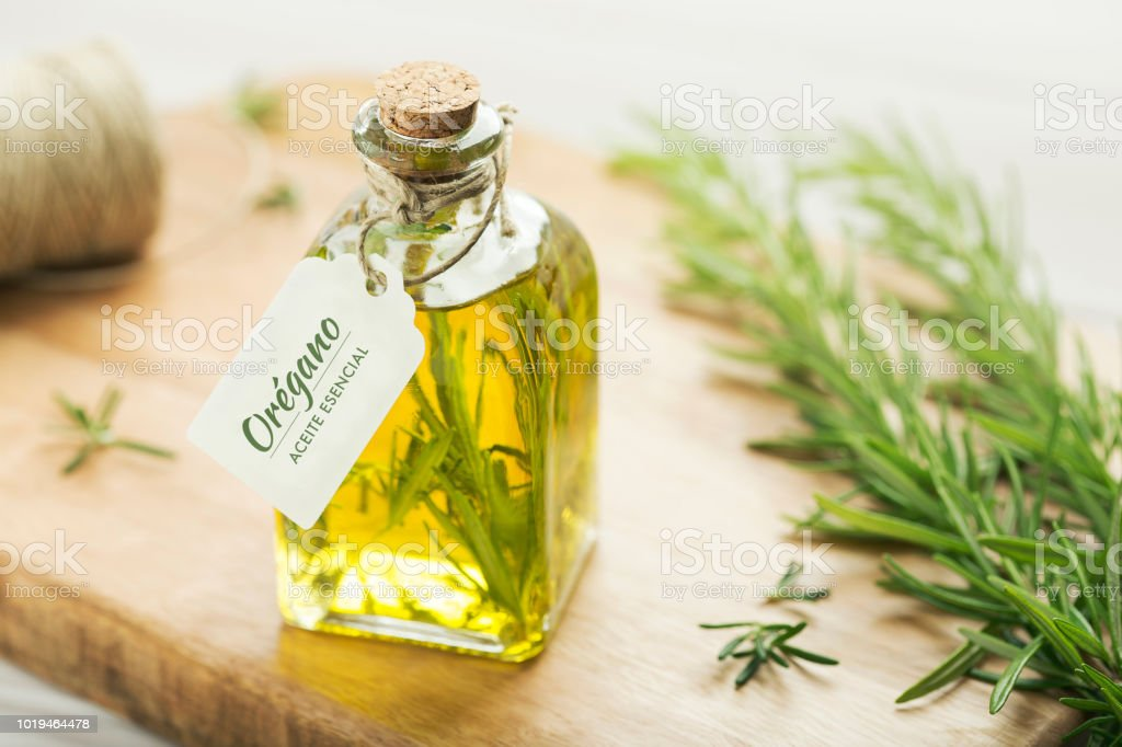 Rosemary oil with spanish tag. stock photo