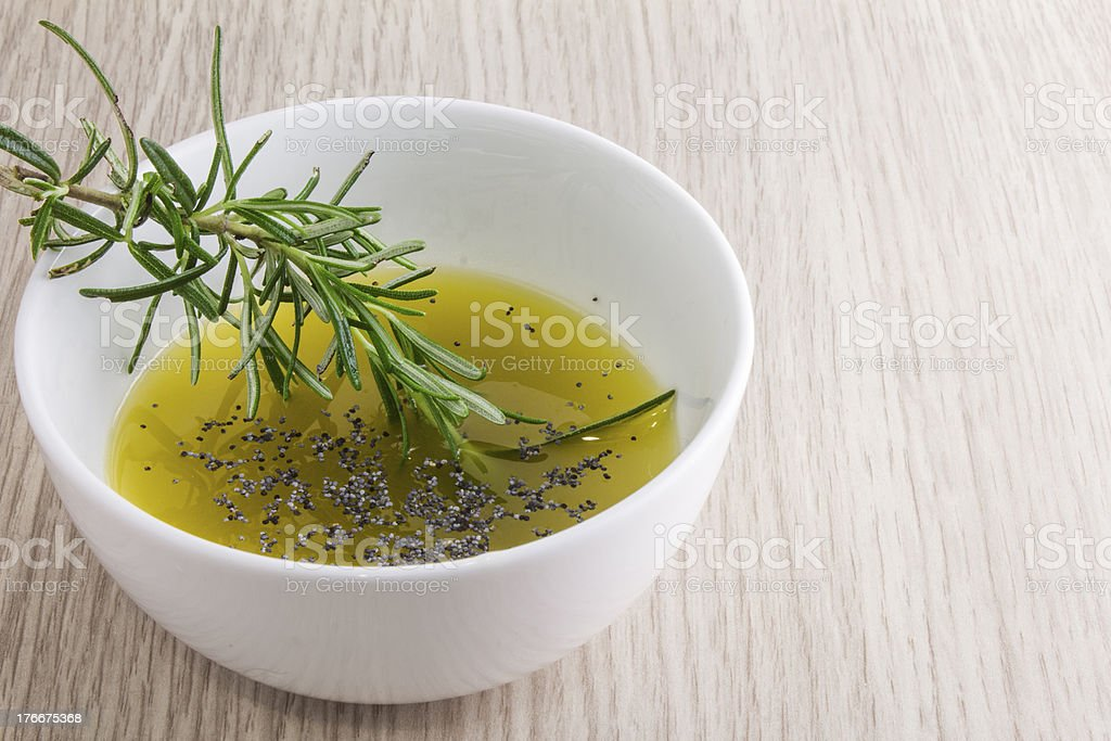 rosemary olive oil sauce in bowl on wood background royalty-free stock photo