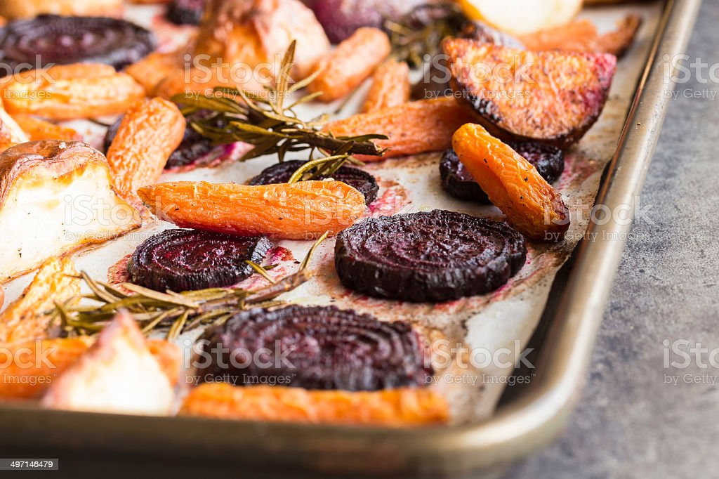 Rosemary roasted root vegetables stock photo