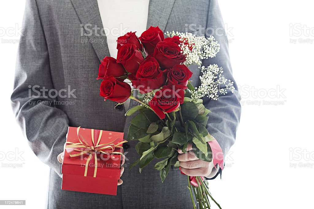 Roses and a gift box royalty-free stock photo