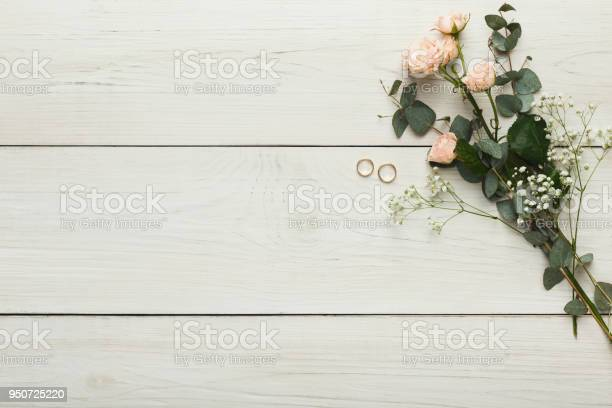 Roses and golden rings on white wood wedding background picture id950725220?b=1&k=6&m=950725220&s=612x612&h=jzy1shr yaa ehglmt5esjgf5zd3fb5covkrks5b3v4=