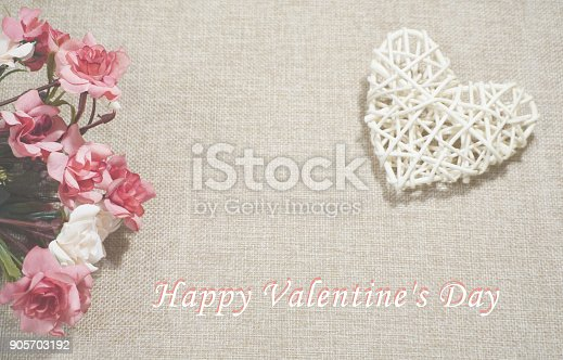 istock Roses and heart on the jute background with Happy Valentine's Day text 905703192