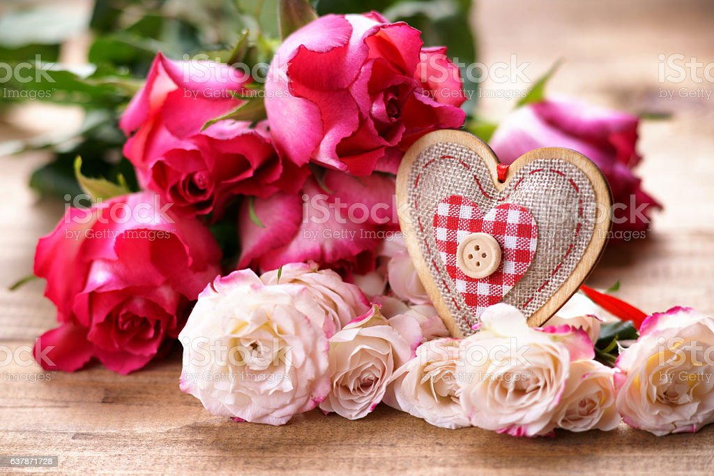 Roses and heart shape stock photo