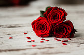 Roses and little hearts on wooden background