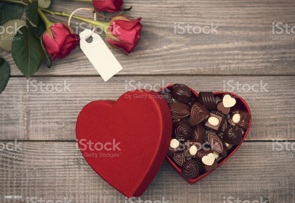 Roses and opened chocolate box stock photo
