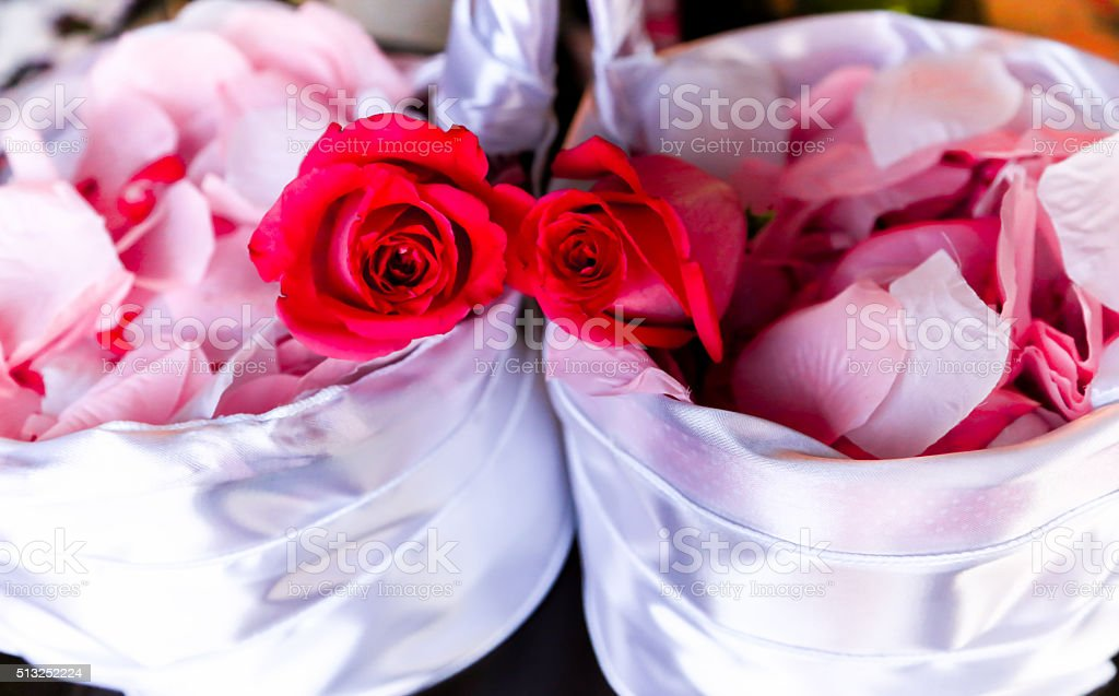 Roses and rose petals in baskets stock photo
